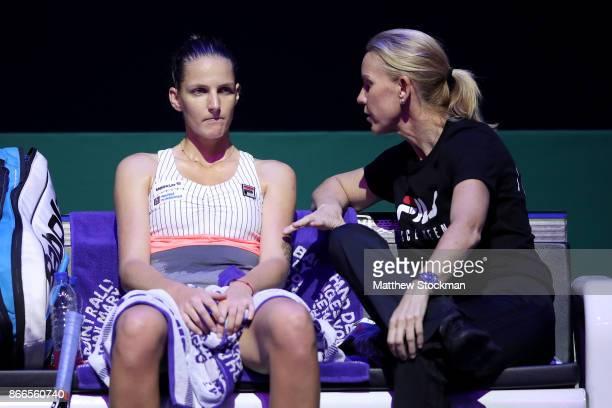 Karolina Pliskova of Czech Republic talks with coach Rennae Stubbs of Australia in her singles match against Jelena Ostapenko of Latvia during day 5...