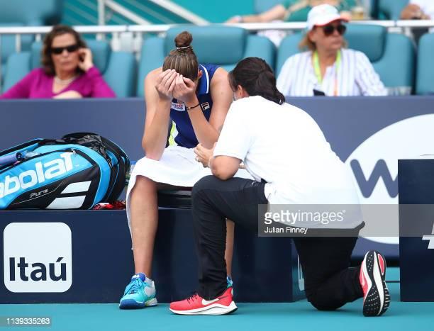Karolina Pliskova of Czech Republic with coach Conchita Martinez against Ashleigh Barty of Australia in the final during day thirteen of the Miami...