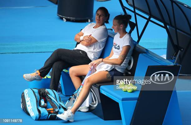 Karolina Pliskova of the Czech Republic and her coach Conchita Martinez look on during a practice session ahead of the 2019 Australian Open at...