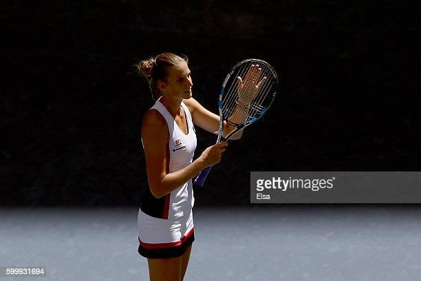Karolina Pliskova of the Czech Republic celebrates after defeating Ana Konjuh of Croatia in their Women's Singles Quarterfinal match on Day Ten of...