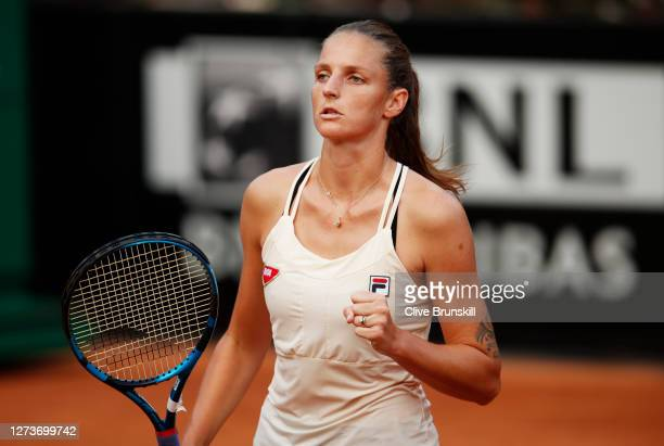 Karolina Pliskova of The Czech Republic celebrates after winning the first set in her semifinal match against Marketa Vondrousova of The Czech...