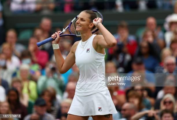 Karolina Pliskova of The Czech Republic celebrates victory after winning her Ladies' Singles Quarter Final match against Viktorija Golubic of...