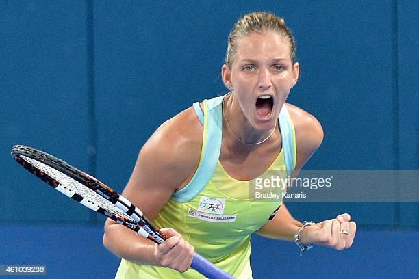Karolina Pliskova of the Czech Republic celebrates victory after defeating Victoria Azarenka of Belarus during day two of the 2015 Brisbane...