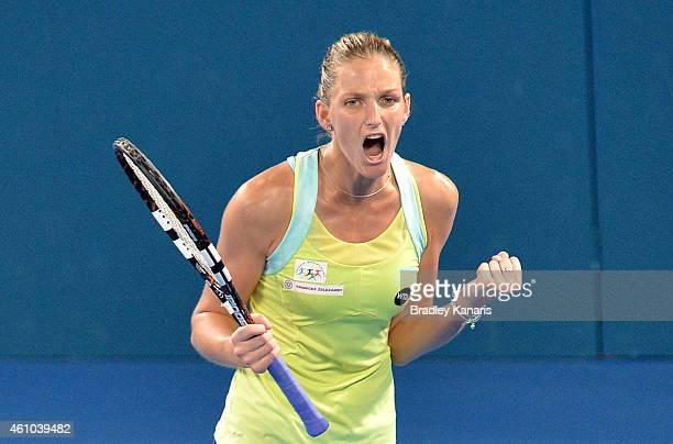 Karolina Pliskova of the Czech Republic celebrates victory after defeating Victoria Azarenka of Belarus during day two of the 2015 Brisbane...