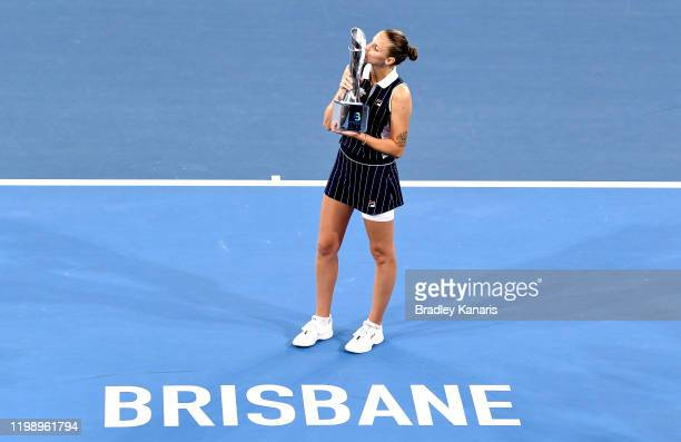 Karolina Pliskova of The Czech Republic celebrates victory as she kisses the winners trophy after the finals match against Madison Keys of the USA...