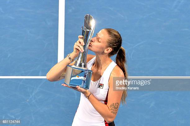 Karolina Pliskova of the Czech Republic celebrates victory as she kisses winners trophy after her match against Alize Cornet of France during the...
