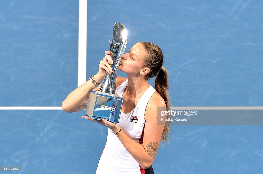 Karolina Pliskova of the Czech Republic celebrates victory as she kisses the winners trophy after her match against Alize Cornet of France during the Women's Final on day seven of the 2017 Brisbane International at Pat Rafter Arena on January 7, 2017 in Brisbane, Australia.