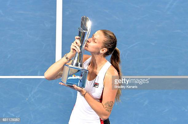 Karolina Pliskova of the Czech Republic celebrates victory as she kisses the winners trophy after her match against Alize Cornet of France during the...