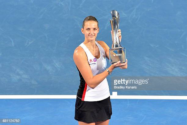 Karolina Pliskova of the Czech Republic celebrates victory as she holds up the winners trophy after her match against Alize Cornet of France during...
