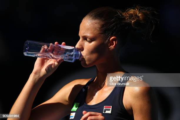 Karolina Pliskova of the Czech Republic cools down between games in her quarterfinal match against Simona Halep of Romania on day 10 of the 2018...