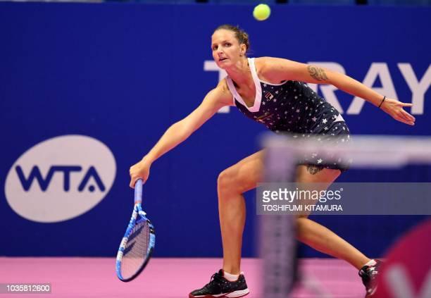 Karolina Pliskova of the Czech Republic hits a return against Daria Gavrilova of Australia during their women's singles second round match at the Pan...