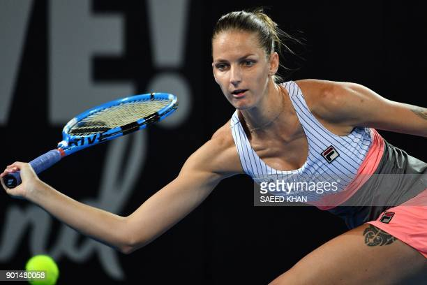 Karolina Pliskova of the Czech Republic hits a return against Elina Svitolina of Ukraine during their women's singles semifinal match at the Brisbane...
