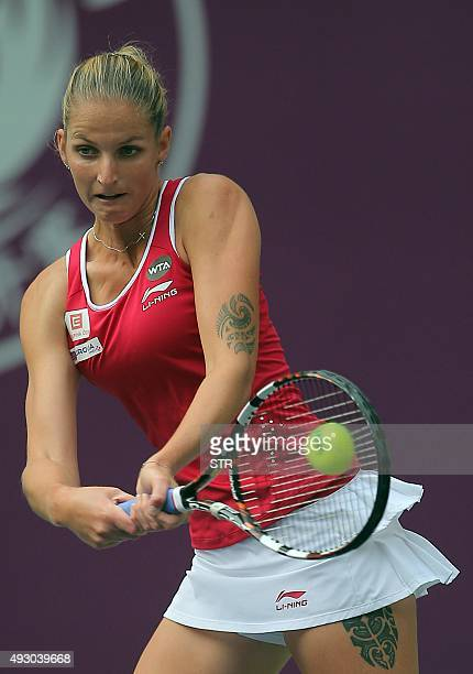 Karolina Pliskova of the Czech Republic hits a return against Agnieszka Radwanska of Poland during their women's singles semifinal match at the...