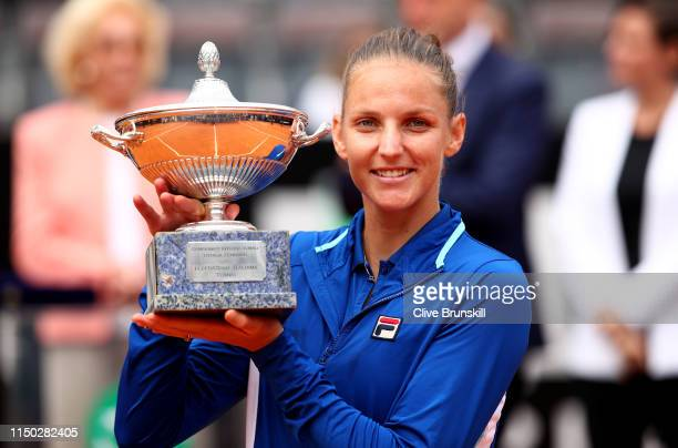 Karolina Pliskova of the Czech Republic holds her winners trophy after her straight sets victory against Johanna Konta of Great Britain in the...