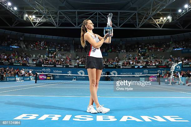 Karolina Pliskova of the Czech Republic holds the winners trophy after her match against Alize Cornet of France in the Women's Final on day seven of...