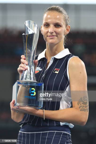 Karolina Pliskova of The Czech Republic holds the winners trophy after the finals match against Madison Keys of the USA during day seven of the 2020...