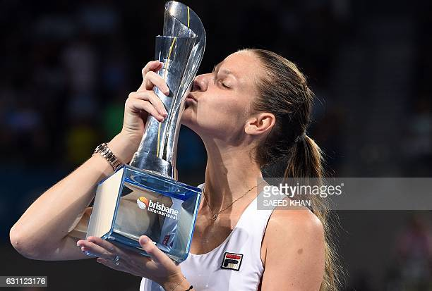 Karolina Pliskova of the Czech Republic kisses her trophy after defeating Alize Cornet of France in their women's singles final match at the Brisbane...