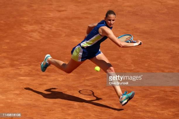 Karolina Pliskova of the Czech Republic plays a backhand against Victoria Azarenka of Belarus in their Women's Singles quarter final match during Day...
