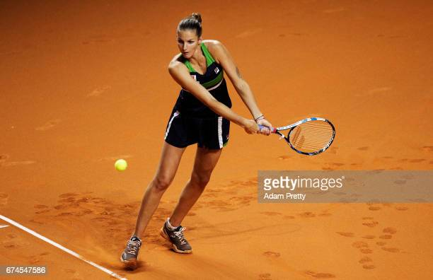 Karolina Pliskova of the Czech Republic plays a backhand during her match against Laura Siegemund of Germany during the Porsche Tennis Grand Prix at...