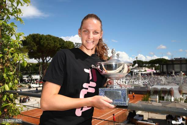Karolina Pliskova of the Czech Republic poses for a photograph with her winners trophy after her straight sets victory against Johanna Konta of Great...