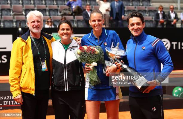 Karolina Pliskova of the Czech Republic poses for a photograph with husband Michal Hrdlicka and her coach Conchita Martinez after her straight sets...