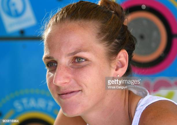 Karolina Pliskova of the Czech Republic poses for photos at autograph island on day three of the 2018 Australian Open at Melbourne Park on January 17...