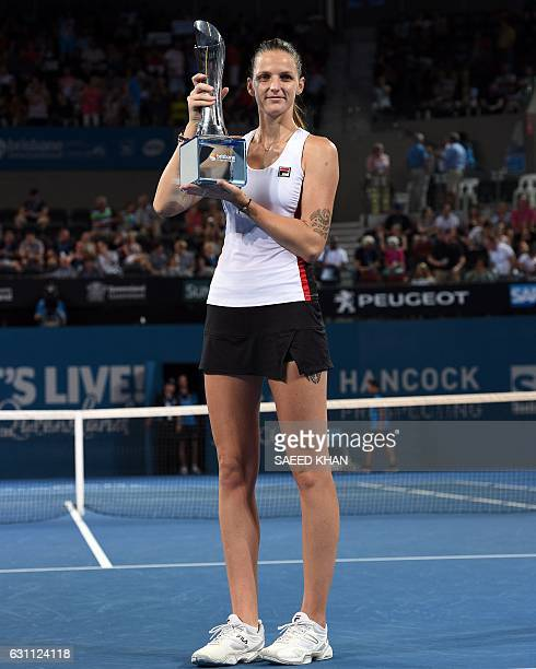 Karolina Pliskova of the Czech Republic poses with her trophy after defeating Alize Cornet of France in their women's singles final match at the...