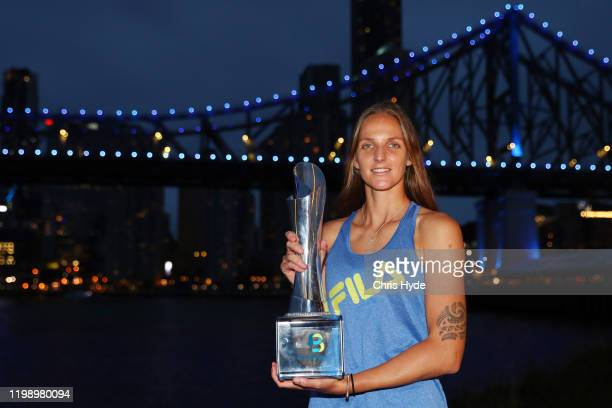 Karolina Pliskova of The Czech Republic poses with the Evonne GoolagongCawley trophy after the finals match against Madison Keys of the USA during...