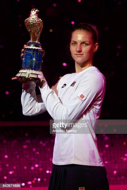 Karolina Pliskova of the Czech Republic poses with the victory trophy after beating Denmark's Caroline Wozniacki after their final tennis match in...