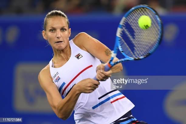Karolina Pliskova of the Czech Republic returns a shot during the match against Amanda Anisimova of The United States on Day 3 of 2019 Dongfeng Motor...