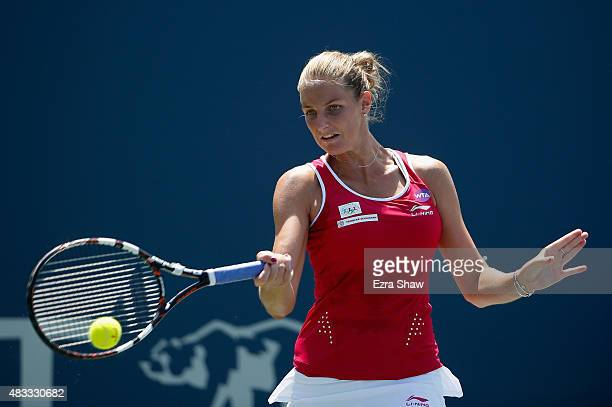 Karolina Pliskova of the Czech Republic returns a shot to Ajla Tomljanovic of Croatia during Day 5 of the Bank of the West Classic at Stanford...