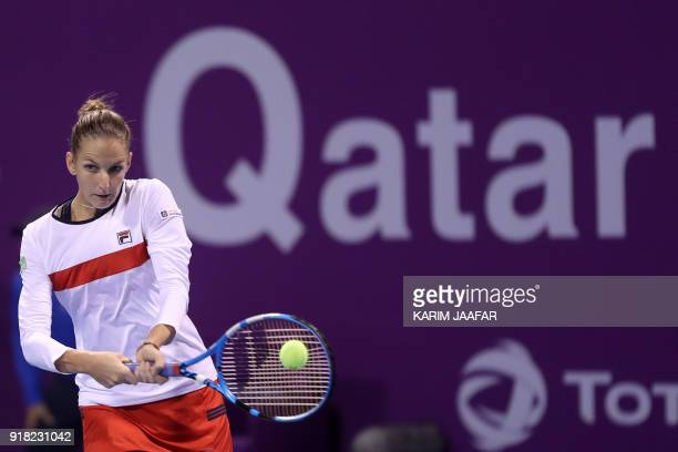 Karolina Pliskova of the Czech Republic returns the ball to Alize Cornet of France as they compete in their singles match during the second round of...