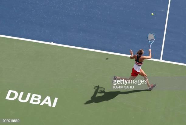 Karolina Pliskova of the Czech Republic returns the ball to Carla Suarez Navarro of Spain during day two of the WTA Dubai Duty Free Tennis...