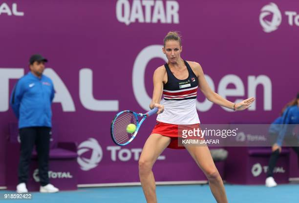 Karolina Pliskova of the Czech Republic returns the ball to Catherine Bellis of the US as they compete in their singles match during the third round...