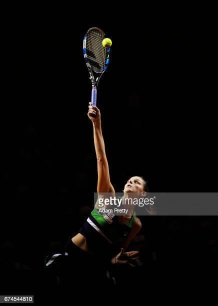 Karolina Pliskova of the Czech Republic serves during her match against Laura Siegemund of Germany during the Porsche Tennis Grand Prix at Porsche...
