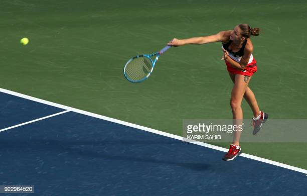 Karolina Pliskova of the Czech Republic serves the ball to Angelique Kerber of Germany during the quarterfinal tennis match in the WTA Dubai Duty...