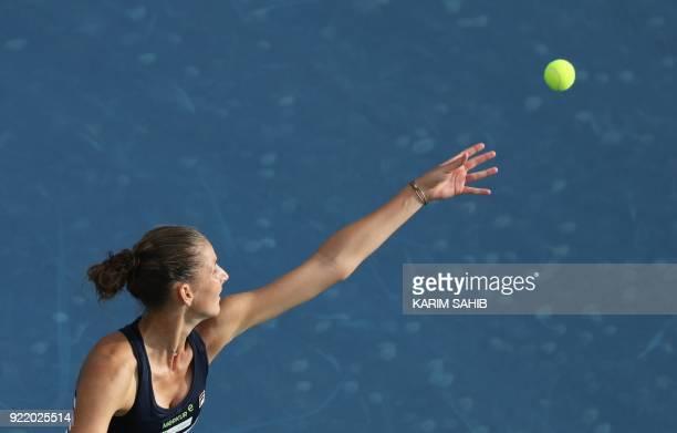 Karolina Pliskova of the Czech Republic serves the ball to Carla Suarez Navarro of Spain during day two of the WTA Dubai Duty Free Tennis...