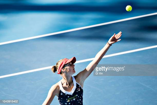 Karolina Pliskova of the Czech Republic serves to Samantha Stosur of Australia during her women's singles first round match at the China National...