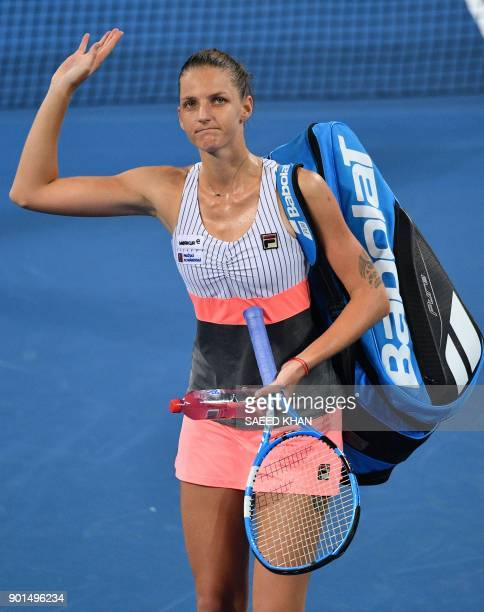 Karolina Pliskova of the Czech Republic waves as she leaves the court after her women's singles semifinal match against Elina Svitolina of Ukraine at...