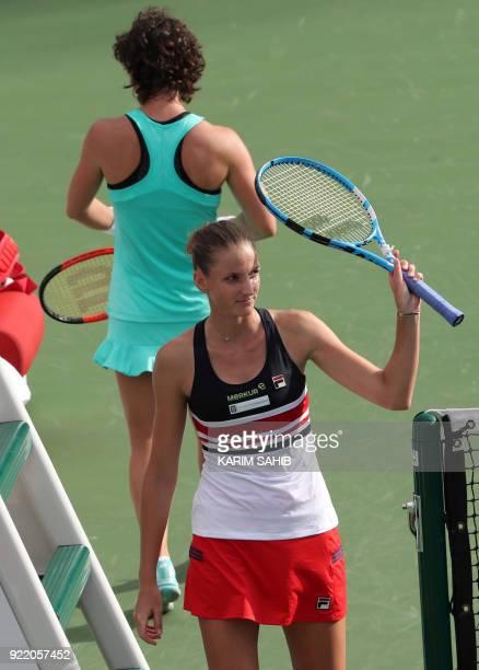 Karolina Pliskova of the Czech Republic waves near Carla Suarez Navarro of Spain during day two of the WTA Dubai Duty Free Tennis Championship at the...