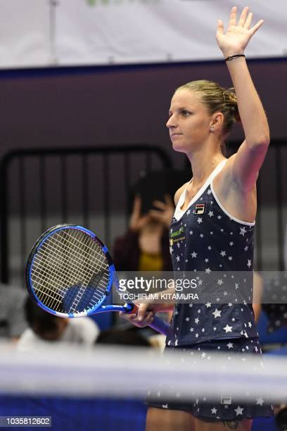 Karolina Pliskova of the Czech Republic waves to the crowd after her victory against Daria Gavrilova of Australia during their women's singles second...
