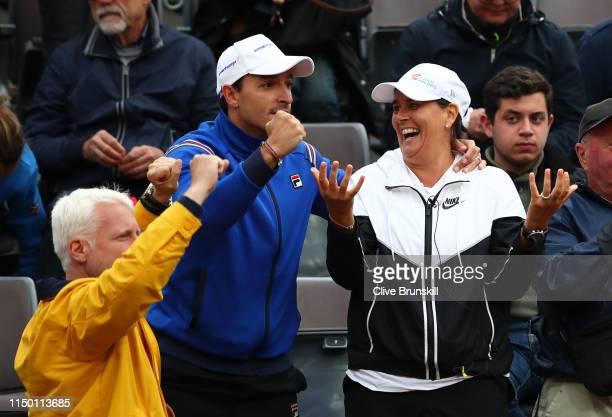 Karolina Pliskova of the Czech Republic's husband Michal Hrdlicka and her coach, the ex Spanish tennis player Conchita Martinez celebrate her...