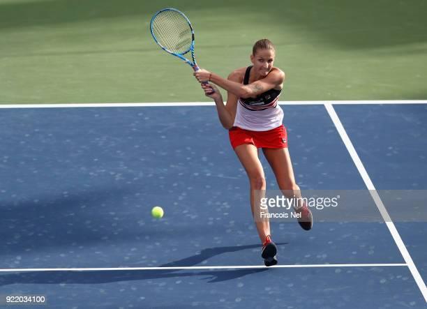 Karolina Ploskova of Czech Republic plays a backhand against Carla Suarez Navarro of Spain during day three of the WTA Dubai Duty Free Tennis...