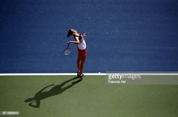 Karolina Ploskova of Czech Republic serves against Carla Suarez Navarro of Spain during day three of the WTA Dubai Duty Free Tennis Championship at...
