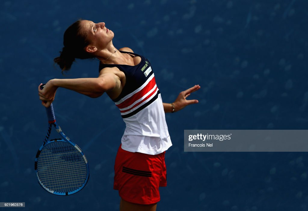 Karolina Ploskova of Czech Republic serves in her match against Carla Suarez Navarro of Spain during day three of the WTA Dubai Duty Free Tennis Championship at the Dubai Tennis Stadiumon February 21, 2018 in Dubai, United Arab Emirates.