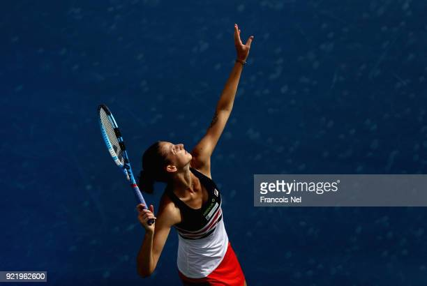 Karolina Ploskova of Czech Republic serves in her match against Carla Suarez Navarro of Spain during day three of the WTA Dubai Duty Free Tennis...