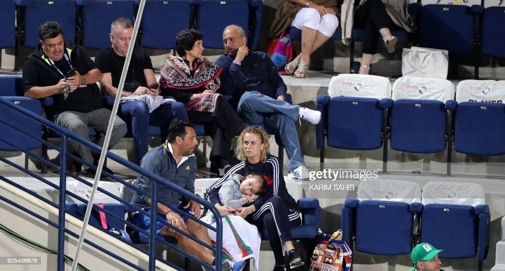 Karolina Sprem Baghdatis, retired Croatian tennis player and wife of Cyprus' Marcos Baghdatis, attends his Dubai Duty Free Tennis singles match on February 28, 2018. /