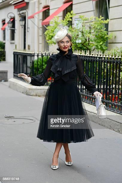 Karolina ZubkovaMattes wears a Dior dress Hermes bag Philip Treacy hat and Manolo Blahnik shoes day 2 of Paris Haute Couture Fashion Week...