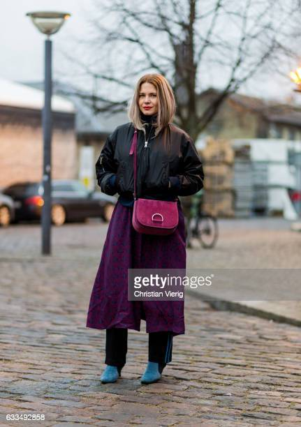 Karoline Concha wearing a black bomber jacket purple bag a dress jogger pants blue ankle boots at the Copenhagen Fashion Week Autumn/Winter 17 on...