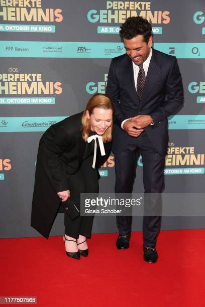 Karoline Herfurth and Elyas M'Barek laugh during the premiere of Das perfekte Geheimnis at Mathaeser Filmpalast on October 21 2019 in Munich Germany